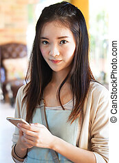 woman holding smart phone
