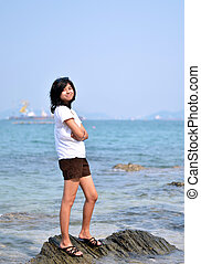 Beautiful young asian woman on beach