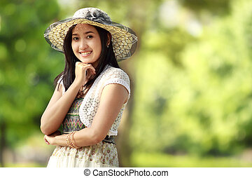 young asian woman smiling outdoor