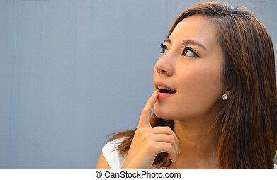 Beautiful young asian woman thinkin