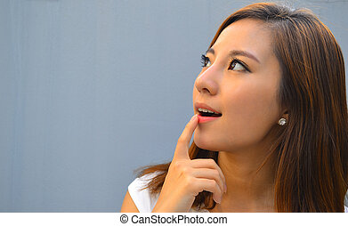 Beautiful young asian woman thinkin