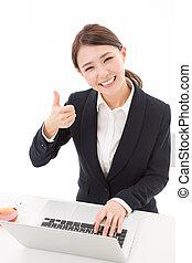 woman using laptop computer - Beautiful young asian woman...