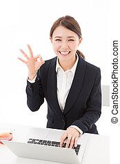 Beautiful young asian woman using laptop computer