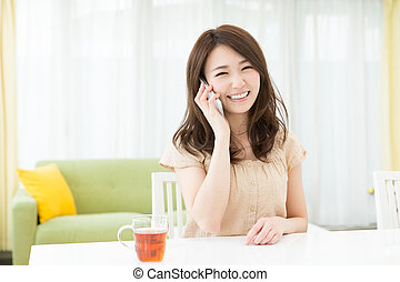 woman who talks on the telephone - Beautiful young asian...