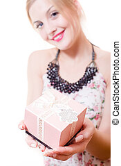 beautiful young attractive woman blue eyes blond girl holding pink box gift in hands & looking at camera portrait on on white background