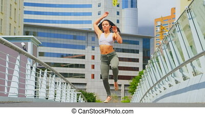 Beautiful young ballerina practicing dance on the bridge in the city 4k