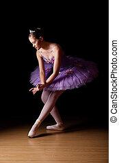 Beautiful young ballet dancer wearing lilac tutu