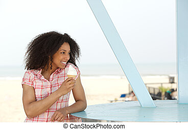 Beautiful young black woman enjoying ice cream