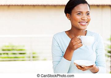 young black woman having coffee