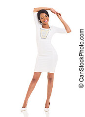 young black woman standing on white