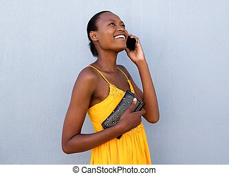 Beautiful young black woman talking on cell phone