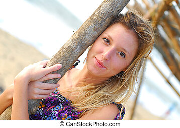 Beautiful young blond girl on beach