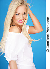 Beautiful young blond with a vivacious smile - Beautiful...