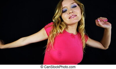 beautiful young blond woman dances in tight top