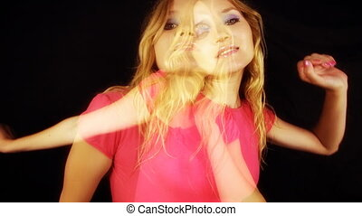 beautiful young blond woman dances, overlay of two videos...