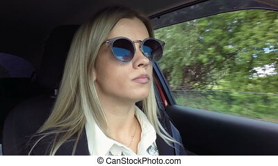 Beautiful young blond woman drives car stock footage video