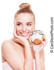 woman eating a bun