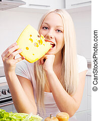 blond woman eating cheese
