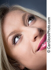 Beautiful Young Blond woman eyes looking up