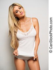 Beautiful young blond woman in a lingerie - Beautiful...