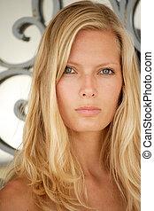 Beautiful young blond woman portrait.