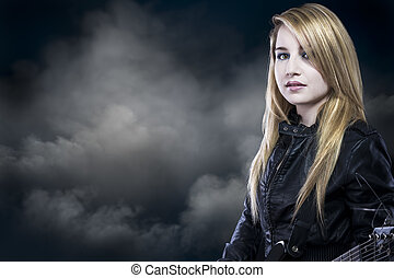 beautiful young blond woman with leather jacket and guitar
