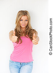 Beautiful young blond woman with thumbs up gesture