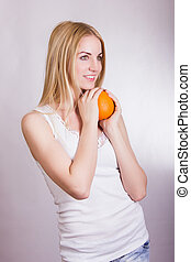 Beautiful young blonde girl posing