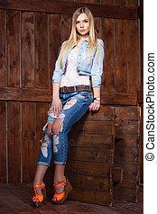 Beautiful young blonde posing in studio.