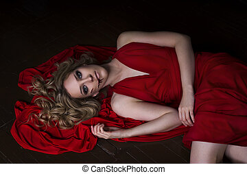 Beautiful young blonde woman in red dress with Halloween...
