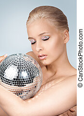 Beautiful young blonde woman with disco ball