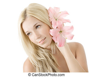 Beautiful young blonde woman with lily flower