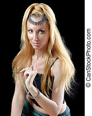beautiful young blonde woman with long hair and jewellery, warning sign points a finger on dark background