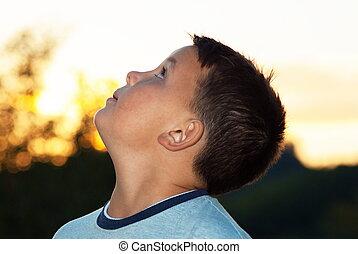 beautiful young boy posing outdoor