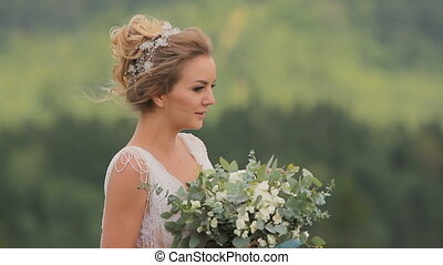 Beautiful Young Bride Holding Bouquet