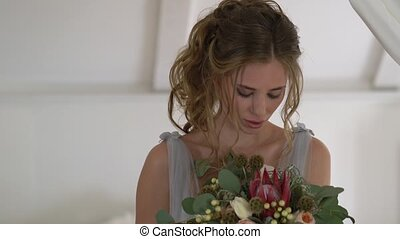 beautiful young bride in a bedroom on the morning of the...