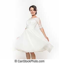 beautiful young bride in flying white dress. Light white cloth flying in the wind. on a white background