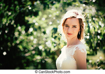beautiful young bride in the garden background