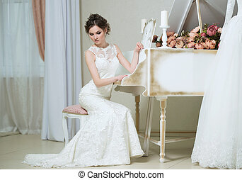 Beautiful young bride portrait with wedding makeup, hairstyle, dress