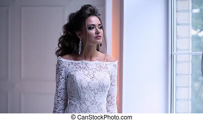 Beautiful young bride posing dolly slow motion
