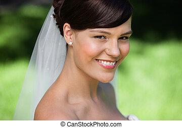 Beautiful young bride smiling