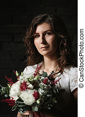 Bride Holding Luxuriant Bouquet of Flowers