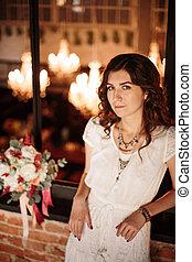 Bride Standing Alone in Luxury Loft Interior