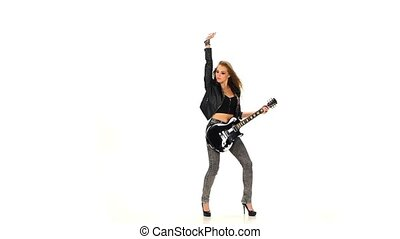 Beautiful young brunette girl dancing with electric guitar on a white background. Slow motion.