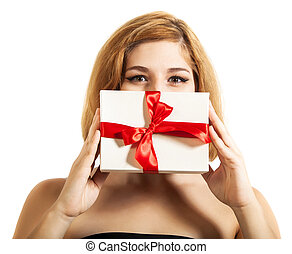 Beautiful young brunette girl holding present