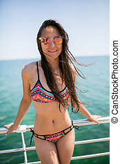 beautiful young brunette girl in a swimsuit