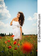 Beautiful young brunette girl wearing white summer dress in...