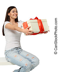 Beautiful young brunette girl with present