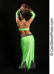 brunette in a green suit oriental dance