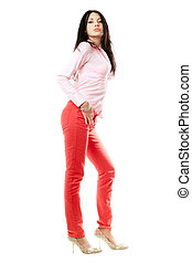 Beautiful young brunette in red jeans